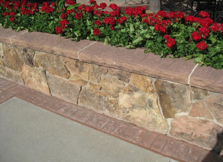 moss rock wall with flagstone cap