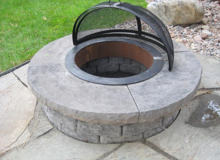 wood burning fit pit with spark screen arrester