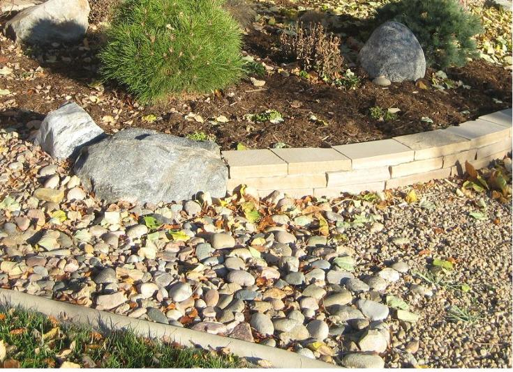 stripstone wall and granite boulder